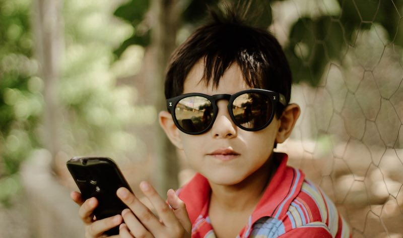 child holding a smartphone
